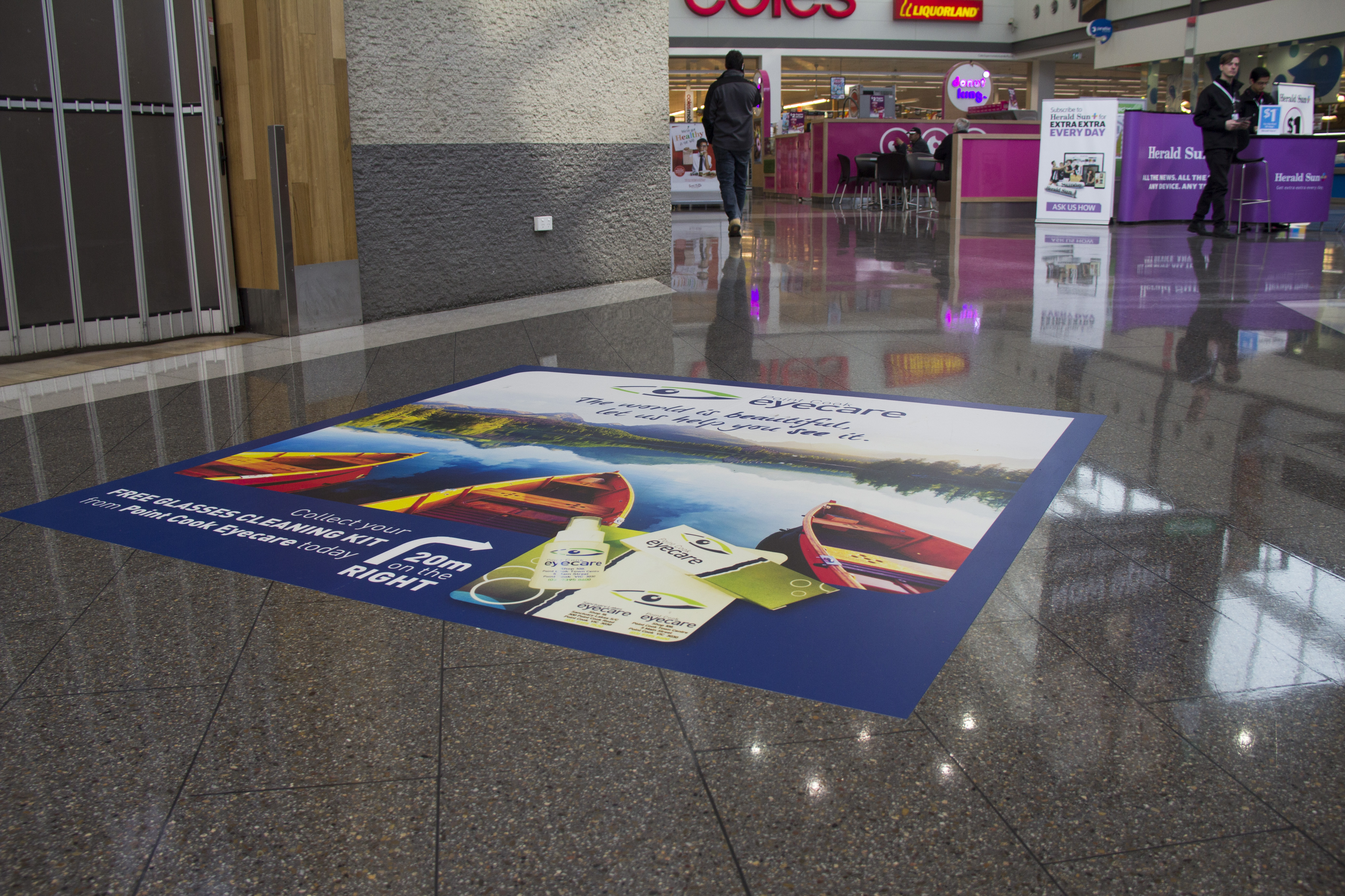 Floor advertising with custom printed floor graphics or floor decals