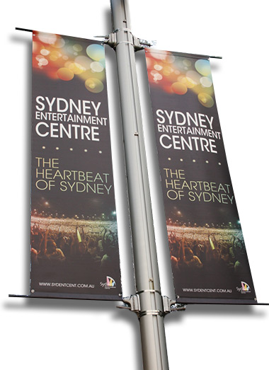 We install banners. Light pole banner installation.